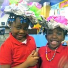 "Kids at Big Thought's Thriving Minds in Dallas ISD  design ""fancy"" hats."