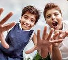 two-happy-boys-outdoors-having-fun-making-faces-to-camera-best-friends-enjoying-holidays-summer-camp-73750969