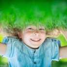 graphicstock-happy-child-standing-upside-down-on-green-grass-laughing-kid-having-fun-in-spring-park-healthy-lifestyle-concept_rLMC_f-Nix_thumb